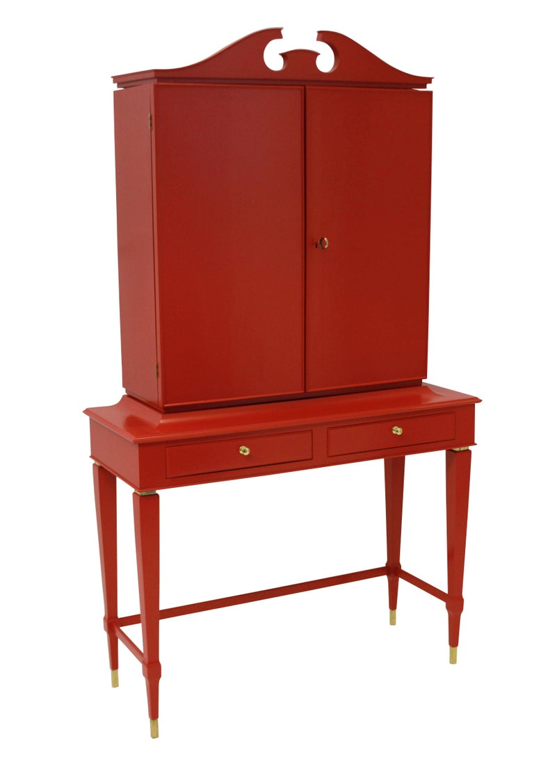 An Italian architectural bar cabinet of fine quality by Paolo Buffa. In red lacquered rosewood, with a fitted interior, and two frieze drawers.