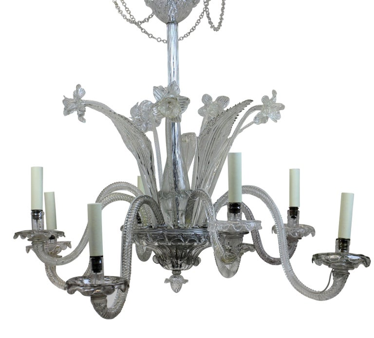 An Italian Murano glass chandelier, with flowers, leaves and swags.