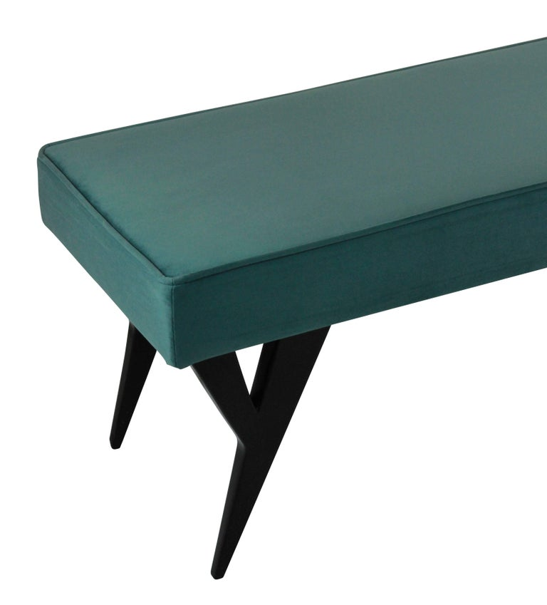 A large bench/stool with architectural legs by Ico Parisi. Newly upholstered in blue velvet.