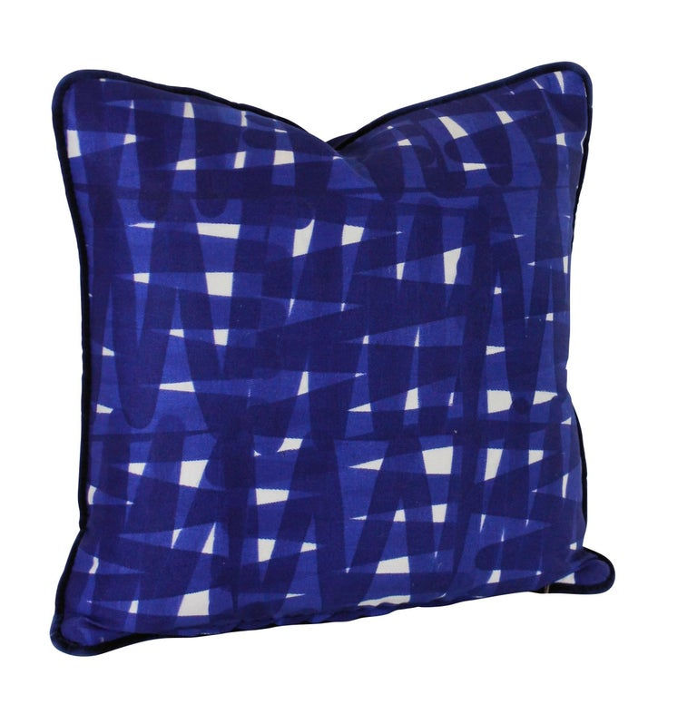 A set of four bespoke cushions in a vivid blue Livio De Simone fabric, piped with Designers Guild velvet. With feather pads.  Sold individually.