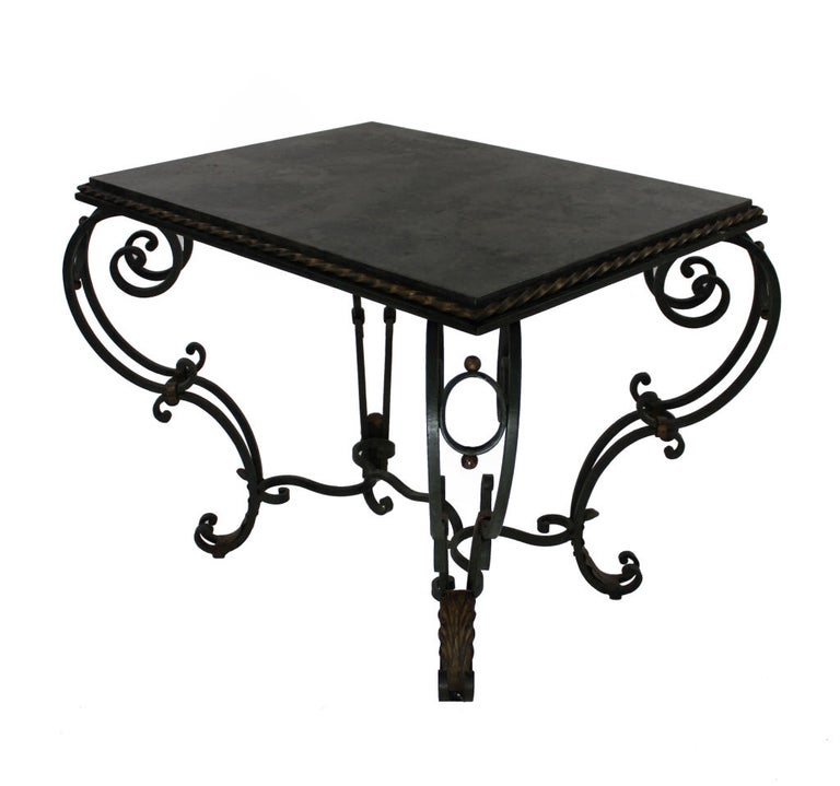A French painted and gilded wrought iron occasional table with a polished blue-limestone top. The paint is a very dark green.