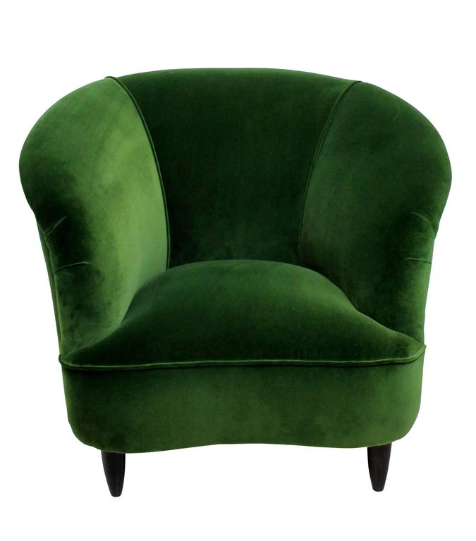 A pair of large Italian sculptural lounge chairs by Parisi. On turned French polished legs seen here in Emerald green velvet for illustration purposes and can be upholstered in a fabric of your choice.
