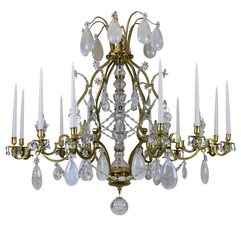 This Louis XIV chandelier is monumental in scale and is of the highest quality of mercury gilded bronze and hung with rock crystal. Of superb proportions and detail. With rams head decoration to each arm, of which there are twelve in total, with