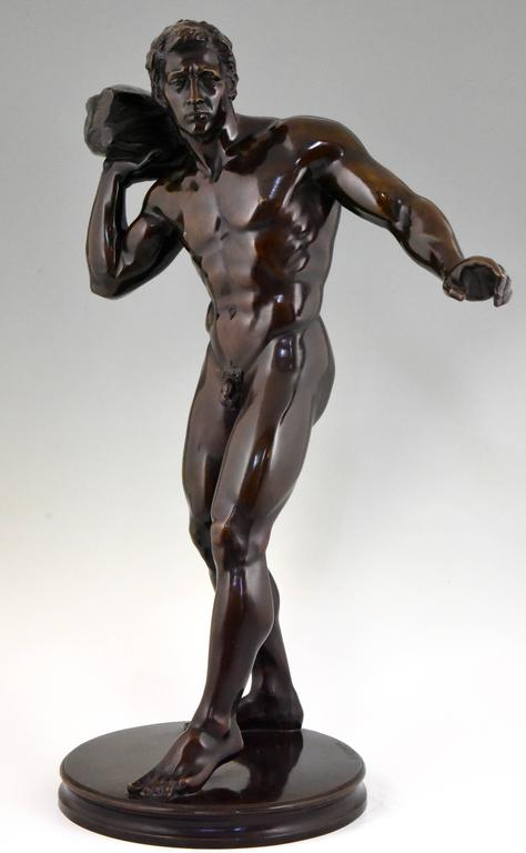 Beautiful bronze sculpture of an athletic man lifting a stone by the German  artist Georg Kemper