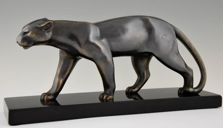 Typical Art Deco bronze panther sculpture by the French artist Bracquemond.   Artist/ Maker: Emile Louis Bracquemond Signature/ Marks: Bracquemond Style: Art Deco. Date: 1930 Material: Bronze, grey patina with shades. ?Belgian black marble