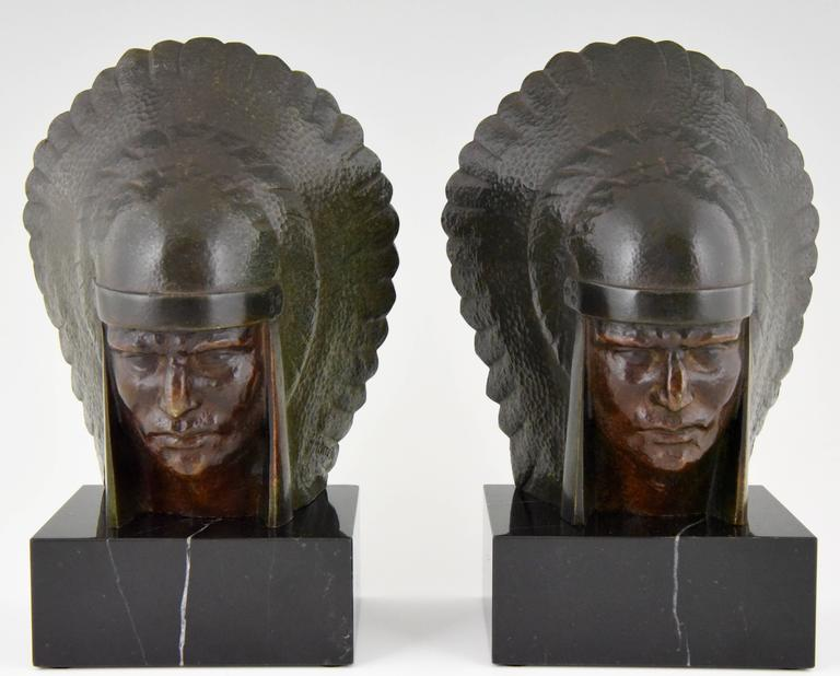 Beautiful pair of Art Deco bronze bookends by the French artist Georges Garreau. 