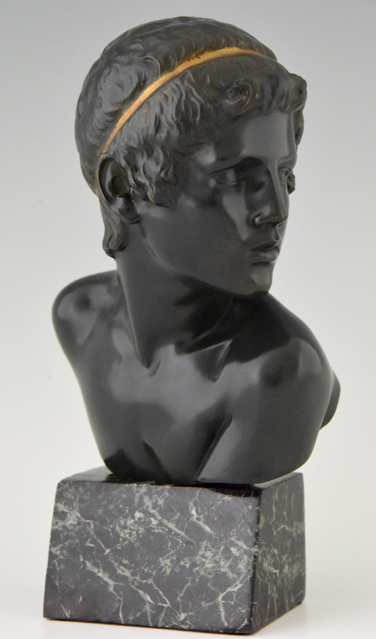 Lovely Art Deco bronze bust of Achilles as a child by the French sculptor Constant Roux. The bronze has a dark green patina with gilt accent. The sculpture is mounted on a green marble base. France, 1920.