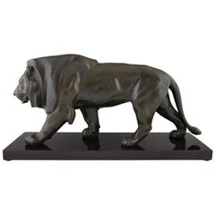 Art Deco Sulpture of a Walking Lion Max Le Verrier, France, 1930