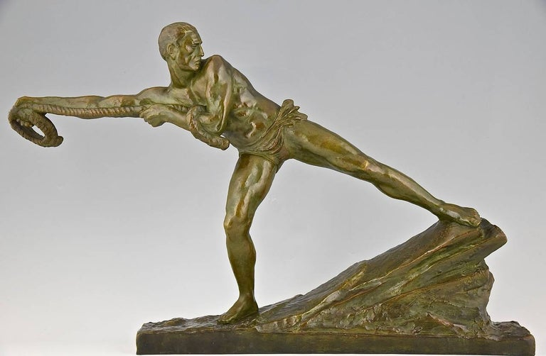 """Art Deco bronze of an athletic man pulling a rope. By Pierre Le Faguays, signed. Bronze. Edited by """"Les Neveux de Lehmann""""?Seal LN Paris JL. Style: Art Deco. Condition: Excellent condition. Date: circa 1930. Material: Bronze, dark green"""