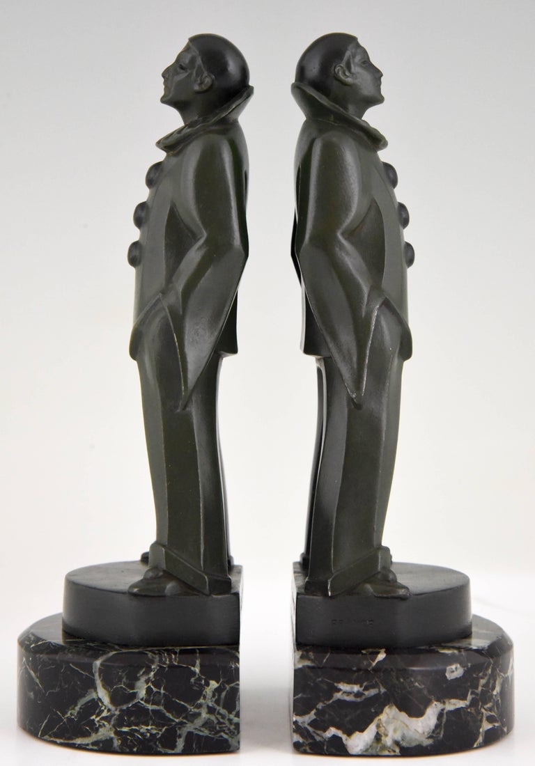 Lovely pair of bookends modelled as standing Pierrots by the French artist Max Le Verrier. Signature/ Marks: M. Le Verrier Style: Art Deco Date: 1930 Material: Green patinated Art metal. Green marble bases. Origin: France Size: H. 20 cm. x L.