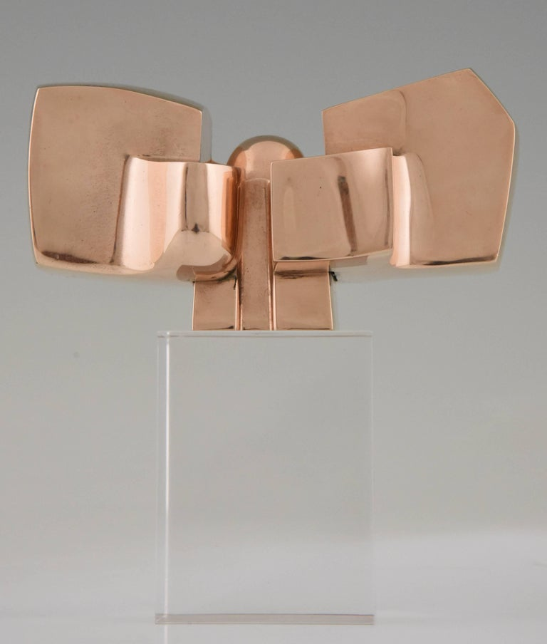 1970's Bronze abstract sculpture on plexiglass base by the Spanish artist José Luis Sanchez.   Artist/ Maker: José Luis Sanchez Signature/ Marks: J.L. Sanchez, Numbered 42/1000 Style: Mid Century Modern Date: 1970. Material: Polished bronze.