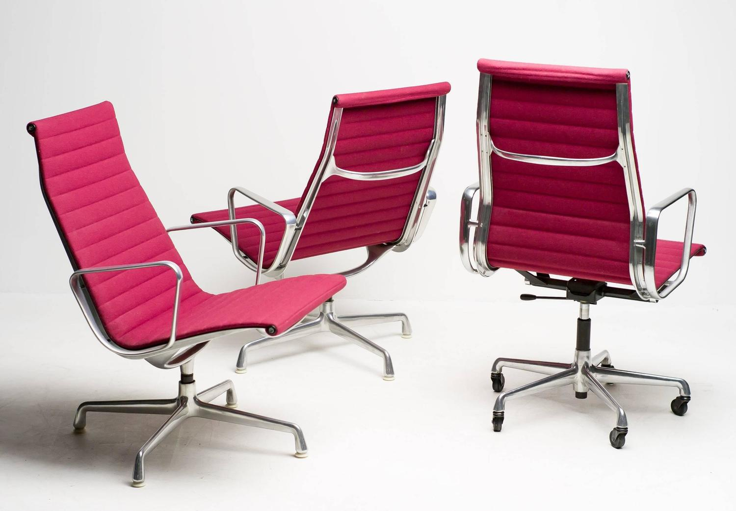 Eames Aluminium Group Chairs in Red For Sale at 1stdibs