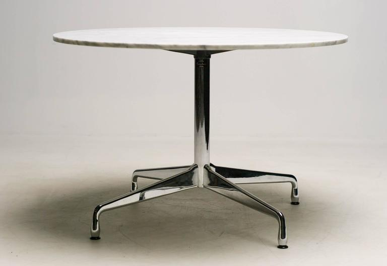 Round Vitra Dining Table Designed By Charles Ray Eames With A Chrome Base And
