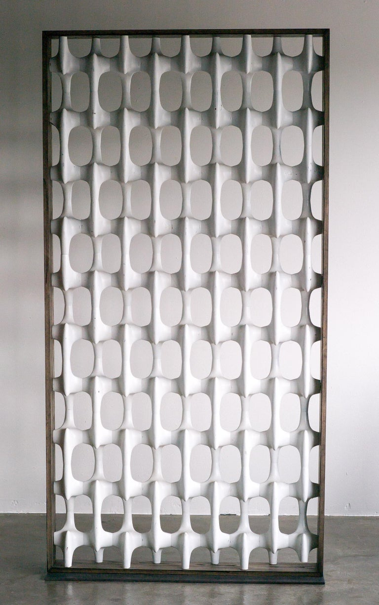 Sculpta-Grille room divider designed by Richard Harvey and manufactured by the Harvey Design Workshop in the 1950s-1960s, in Lynbrook, NY.  Framed in a dark stained wooden frame with a steel base, can be used freestanding. The screen is made of