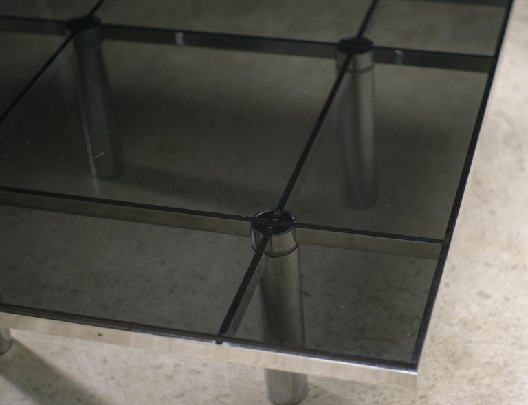 Wonderful large coffee table with chrome base and dark smoke glass top.