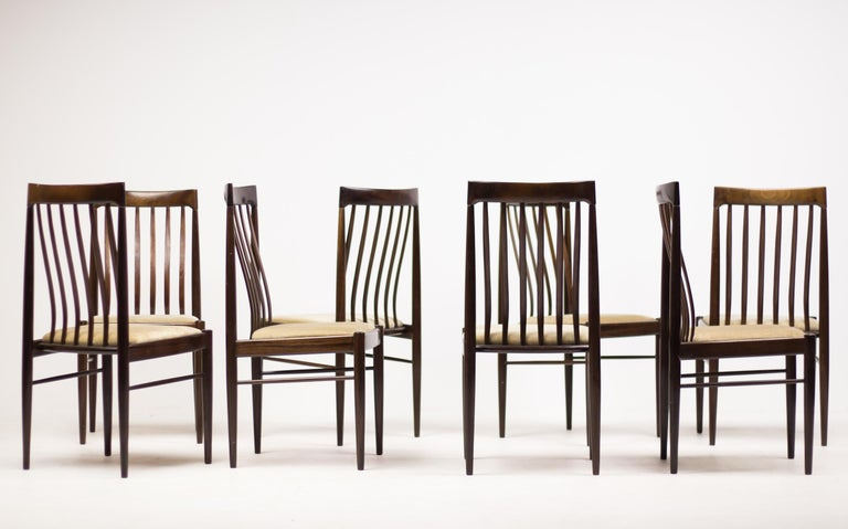 Excellent all original set of eight elegant dining chairs by Henry Walter Klein in mahogany with velvet seats. 