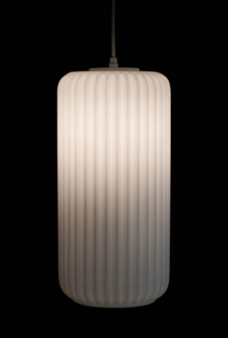 Wonderful Minimalist large 1950s ribbed glass pendant. Attributed to Angelo Lelli for Arredoluce. A similar glass shade is used on several 1950s Angelo Lelli for Arredoluce floor lamps. Unmarked. Three pieces available, priced individually.