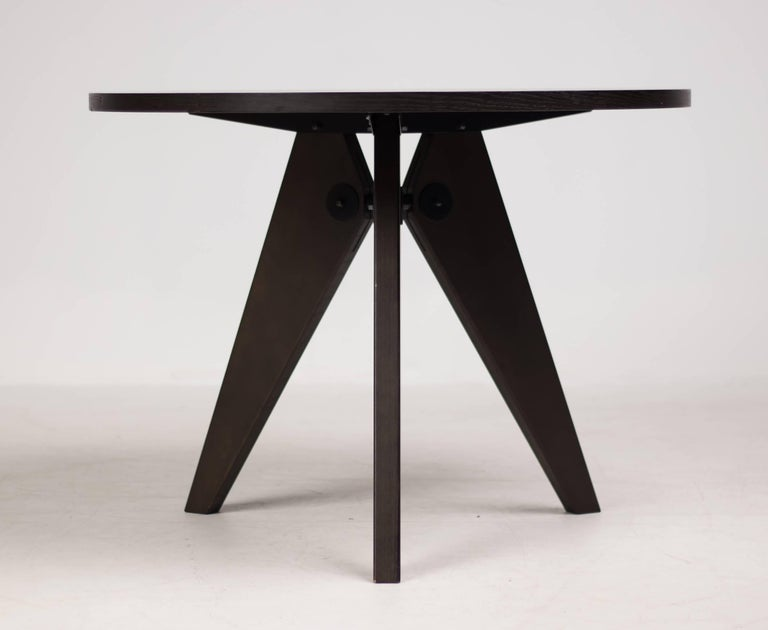 Dark stained oak Guéridon dining table designed by Jean Prouvé for Vitra.