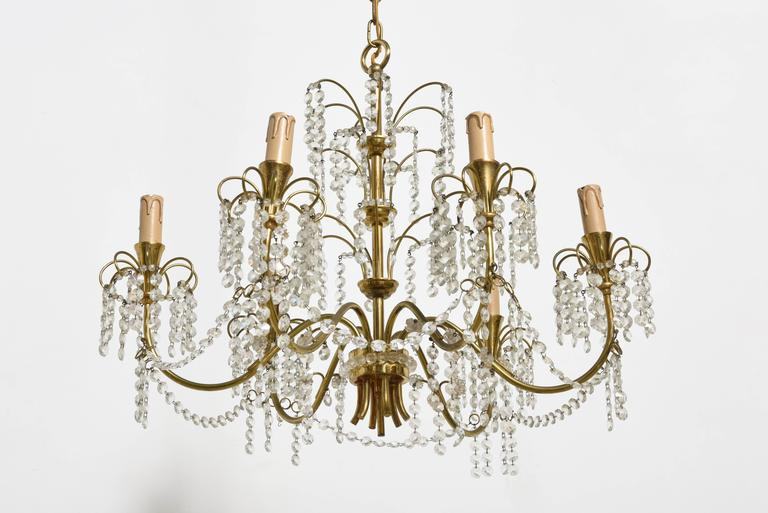 Early six-arm waterfall clear drops chandelier, 1950s crystal faceted, very good condition, romantic edition with fantastic patina on the metal parts.