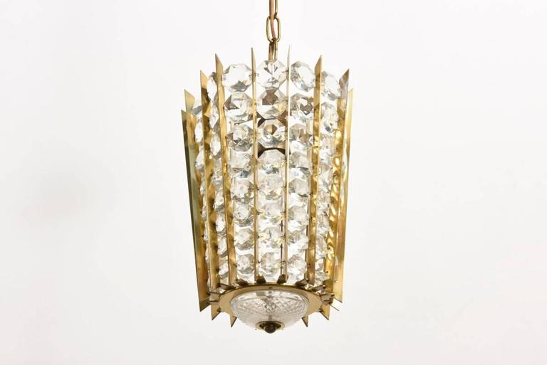 Impressive crystal, brass, gilded chandelier by Bakalowits & Söhne. Brass construction with faceted diamond shaped crystals.