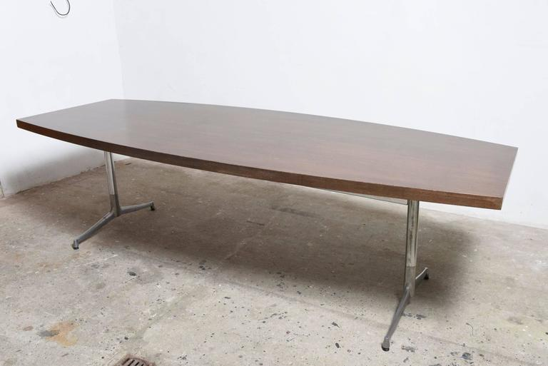 Large Wengé boat shape dining or conference table on chrome base.