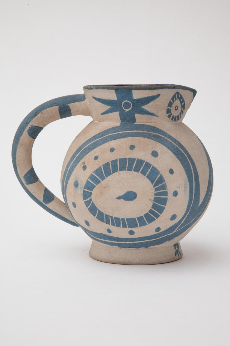 Bisque earthenware pitcher,