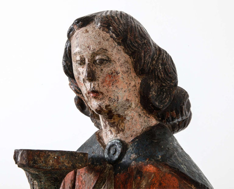 This 15th century oak angel a piece of works of art is a great quality the carving is sober but extremely refined the artist has succeeded wonderfully in displaying this very modest moment in which the miraculous reveals itself in a very serene and