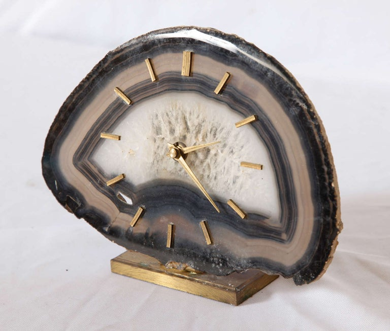 Very great look formed through the nature Agate (polished stone),brass base and display. Table clock, Germany circa 1960s. It works perfectly with a Junghaus clock AA-battery Made in Germany.