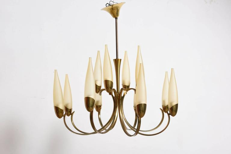 A spectacular brass two-tier chandelier with twelve champagne colored glass shades, 1950s.