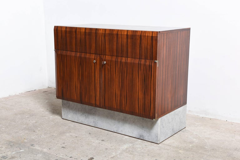 A beautiful original design of De Coene bar furniture from the 1960s, the combination of dark massive wood and white marble makes the furniture extra exclusive.