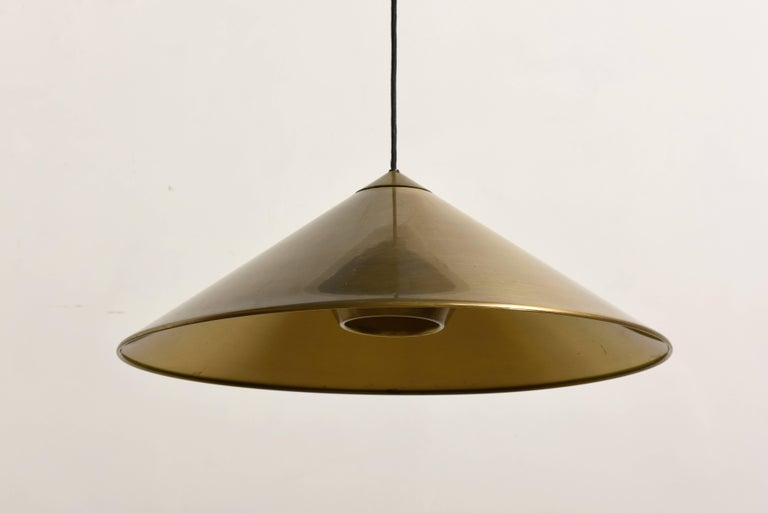 Large elegant adjustable solid counter-balance pendant to easily adjust the light in height,brass brushed shade with diffuser designed by Florian Schulz,Germany.  Beautiful design with diffused light create atmospheric lighting. Excellent