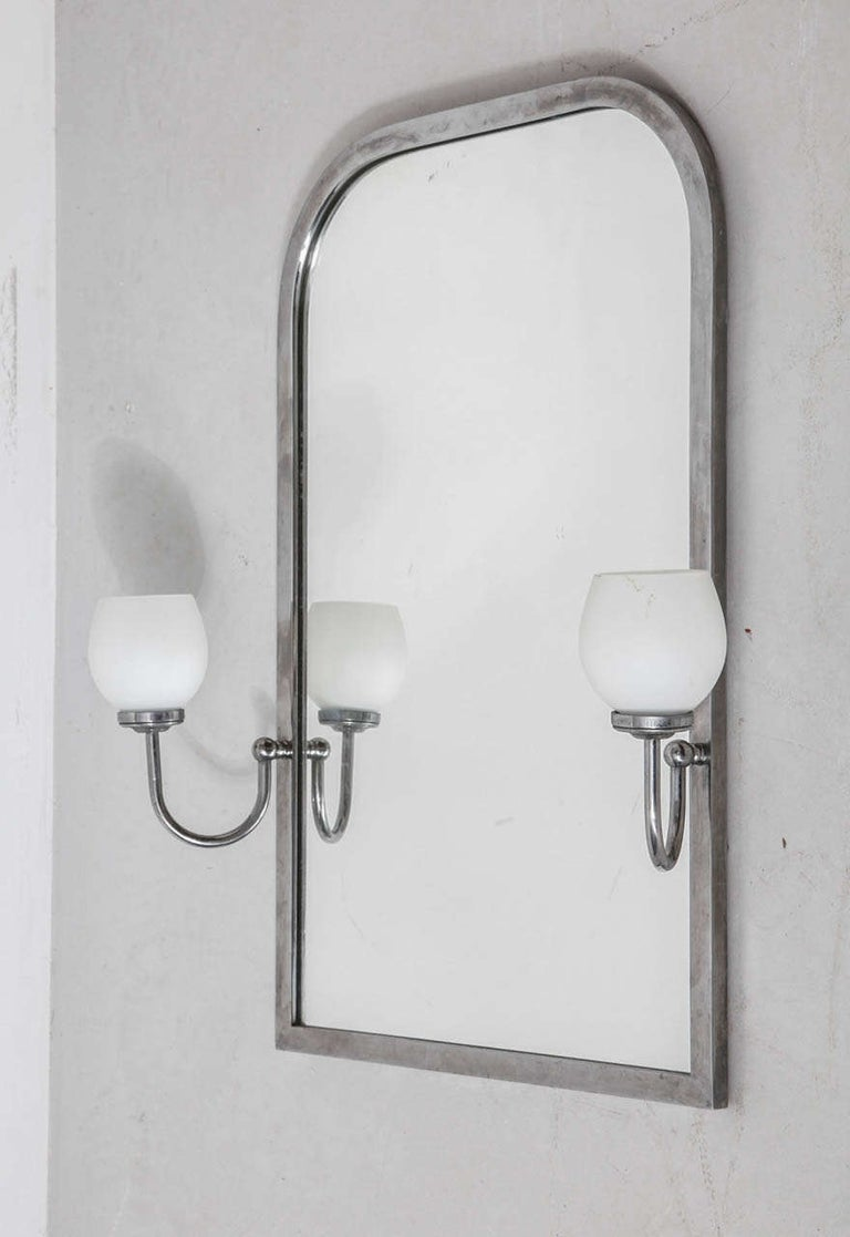 A beautiful stylish large mirror with a chrome frame and adjustable lighting in opal glass on both sides. Stylish in your bathroom or at the entrance of your house.