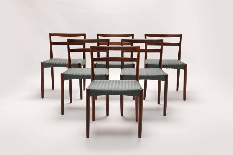 Set of six solid rosewood dining chairs designed in 1961 by Danish designer Harry Østergaard. Made in Denmark by Randers Møbelfabrik in the 1960s. Timeless design in beautiful quality Rosewood executed.  If desired we can reupholster these chairs in