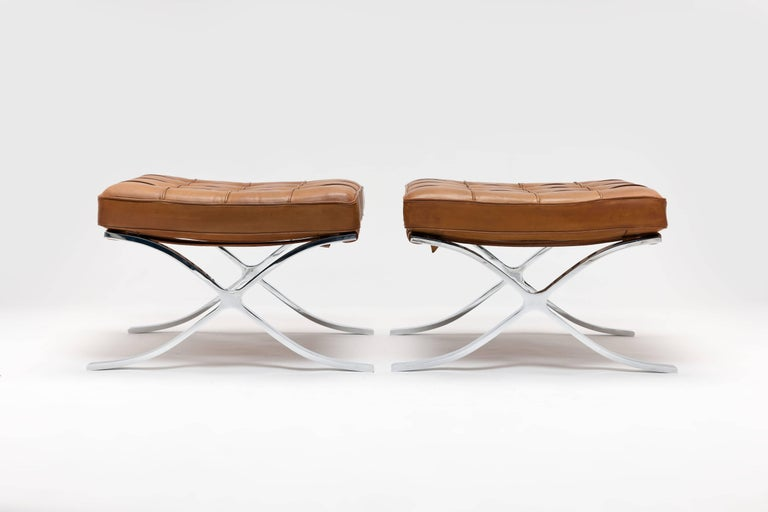 Magnificent and very rare original pair of beautifully aged 1960s Knoll Barcelona stools by Ludwig Mies vd Rohe in original Cognac leather. This is a unique 'marriage' with all original parts in place, traps are complete and original and the high