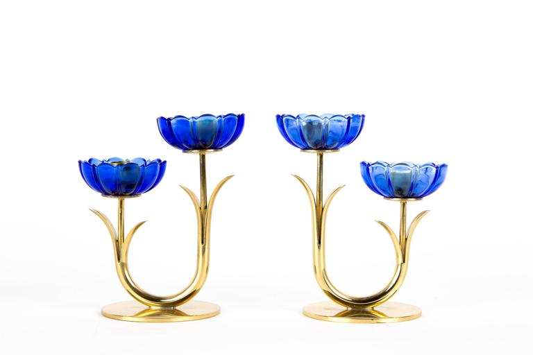 GUNNAR ANDER CANDLE HOLDER. A set of two double candle holders with blue transparent art glass. Designed by Gunnar Ander for Swedish Ystad-Metal. The set is marked on the bottom. The price is for one set double flowers (four flowers). There are two