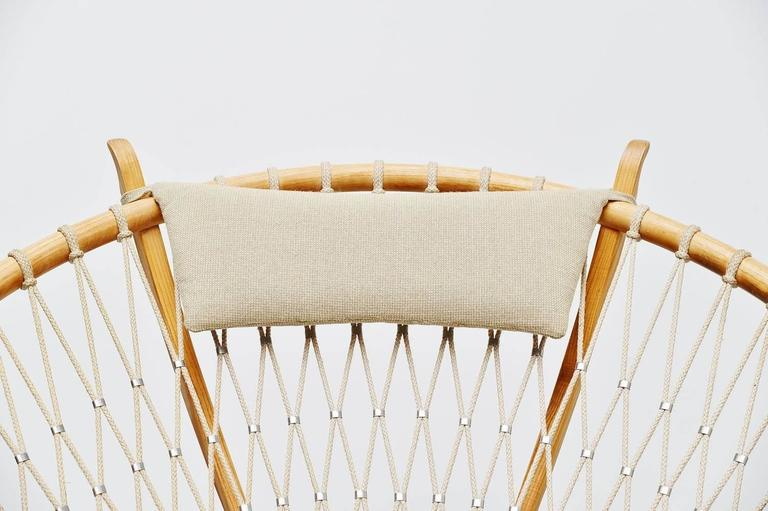 Sophisticated circle lounge chair model PP-130 designed by Hans J. Wegner for PP Mobler, Denmark 1986. This chair is made of solid oak, superbly crafted and finished with rope connected with metal clips. The upholstery is still the original and the