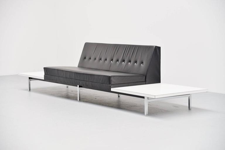 Very nice leather sofa designed by George Nelson for Herman Miller, United States, 1963. This sofa has a metal frame with square chrome plated legs, the seat is in black leather and in excellent original condition. The tables are finished with white