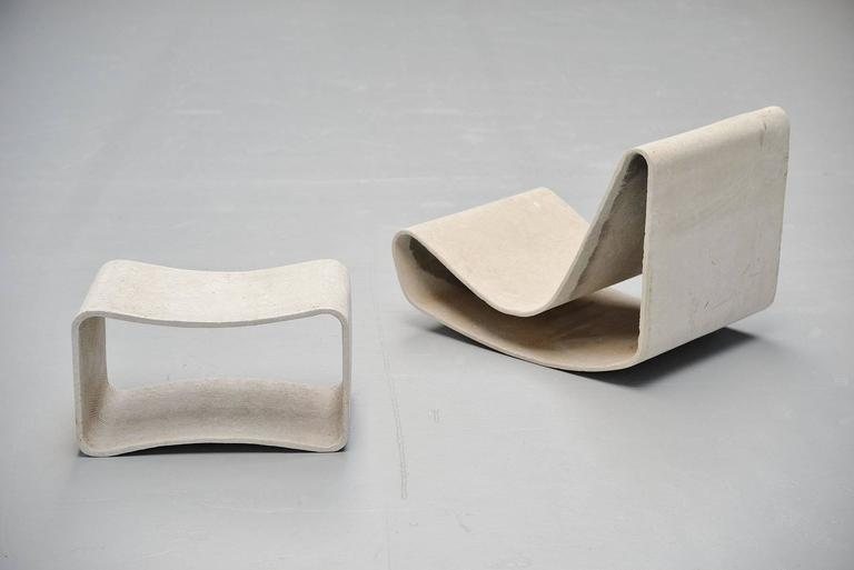 Very nice garden set, loop chair and table designed by Willy Guhl for Eternit, Switzerland, 1954. This chair and table was made of cellulose infused fiber cement and is therefore very strong even when it would have a crack it will not fully break