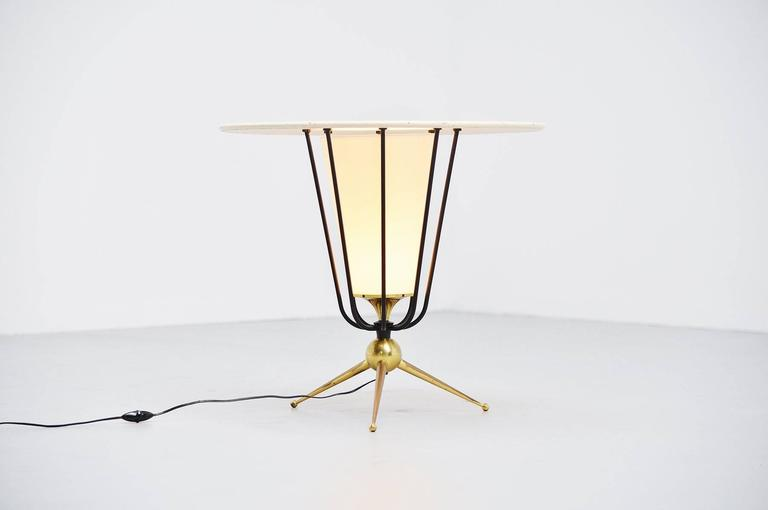 Fantastic large floor lamp possible designed by Pierre Guariche or Jacques Biny for Disderot, France, 1950. This oversized floor lamp has a brass tripod base and black lacquered spines. The die cut top is white lacquered and the shade is made of
