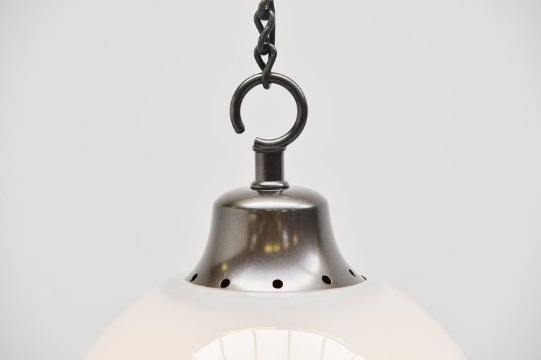 Nice large ceiling fixture designed by Luigi Caccia Dominioni for Azucena, Italy, 1967. This lamp has a metallic painted chain and shade holder, large frosted glass shade. The ceiling lamp gives very nice and spherical light when lit and is very