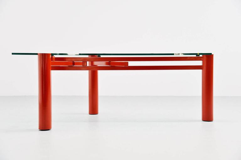 Super rare table designed by Christophe Gevers (1928-2007) produced by be. Classics, Belgium 2001. This extraordinary working table has an ingenious construction of 3 metal legs which slide in each other and create balance with the glass top on it