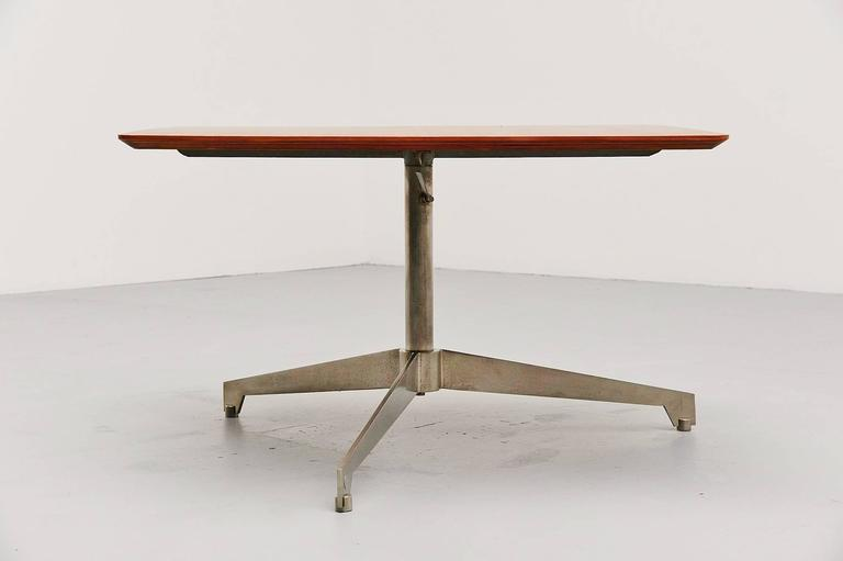 Very nice and unusual adjustable coffee/working table designed by Osvaldo Borsani, manufactured by Tecno, Italy 1960. This table has a chrome-plated metal tripod base which is adjustable in height, from 53 to 73 cm. The top is made of walnut veneer
