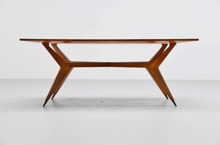 Very rare and early dining table designed by Ico Parisi in own atelier, Italy, 1950. This rare table is from the time before MIM took this similar design into production. This table is hand made and very sophisticated finished. It has a solid walnut