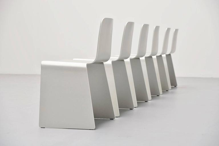 Very nice set of six dining chairs in the style of Scott Burton and Xavier Lust. Unknown manufacturer or designer, circa 1990. These chairs are made of very nice and thin plywood, silver lacquered. There are black plastic protection feet underneath