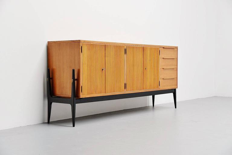 Here for a very nice sideboard often sold as an Alfred Hendrickx design, while in fact this is made by De Coene, Belgium, 1950. And Alfred Hendrickx never worked for de Coene. So the designer is unknown to me but is very beautifully made. This has a