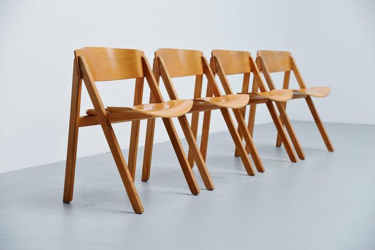 Rare set of four trestle dining chairs designed by Victor Bernt and manufactured by Soren Willadsen, Denmark 1972. These chairs were originally designed for the Olympics in Munich in 1972. The chairs are made of birch teak plywood and have a very