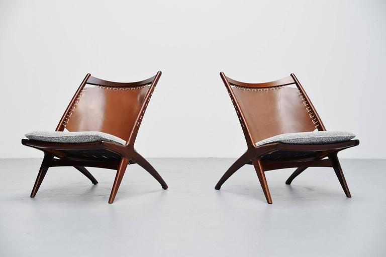 Rare pair of lounge chairs designed by Frederik Kayser and manufactured by Gustav Bahus, Norway, 1955. The chairs have a solid teak wooden frame and a very nice leather back fixed to the teak wooden frame with a white rope. The seats are