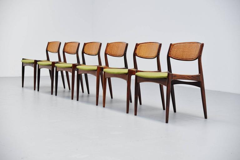Stunning set of dining chairs designed by Ib Kofod Larsen and manufactures by Chrisian Linneberg, Denmark, 1960. These chairs are model 4325 and have a solid rosewood frame, cane work inlay back and newly upholstered seats with Divina fabric by