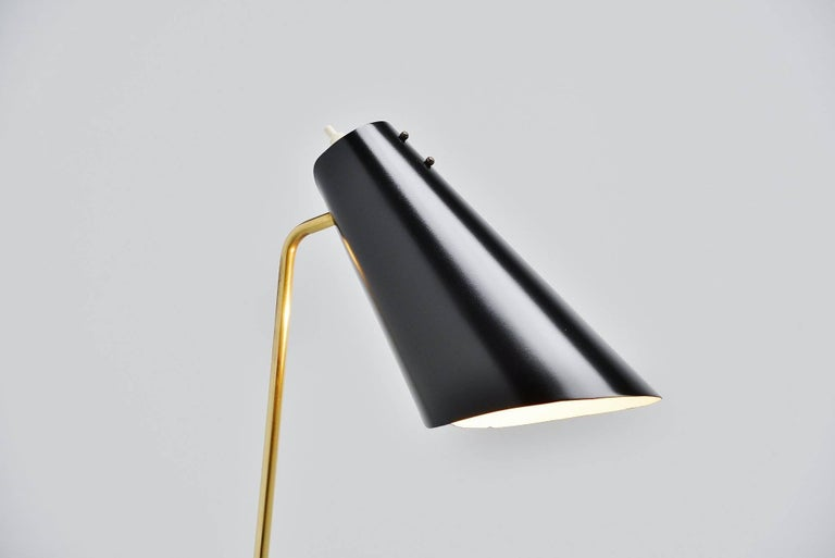 Nice small reading floor lamp designed and manufactured by ASEA Belysning, Sweden 1960. This floor lamp has a black lacquered weighted base and a brass arm. Adjustable black lacquered shade, refinished so in perfect condition. The lamp gives very
