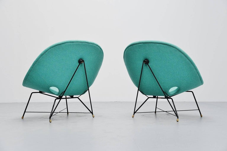 Super rare cosmos lounge chairs designed by Augusto Bozzi for Saporiti Italia, Italy, 1954. These chairs have a black lacquered metal wire frame with solid brass feet. The chairs are newly upholstered with Flora fabric by Kvadrat so they are in